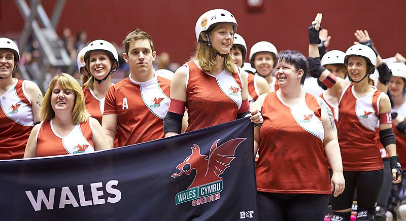 Professor Moriarty, at the left, walking out with Team Wales in Dallas. (Photo: Jason Ruffell, Roller-derby-on-film.)