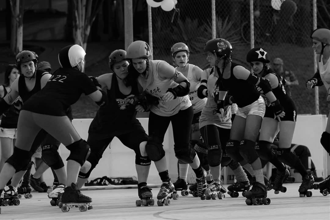 P-Town Roller Derby intraleague photo, both jammers exiting the pack.