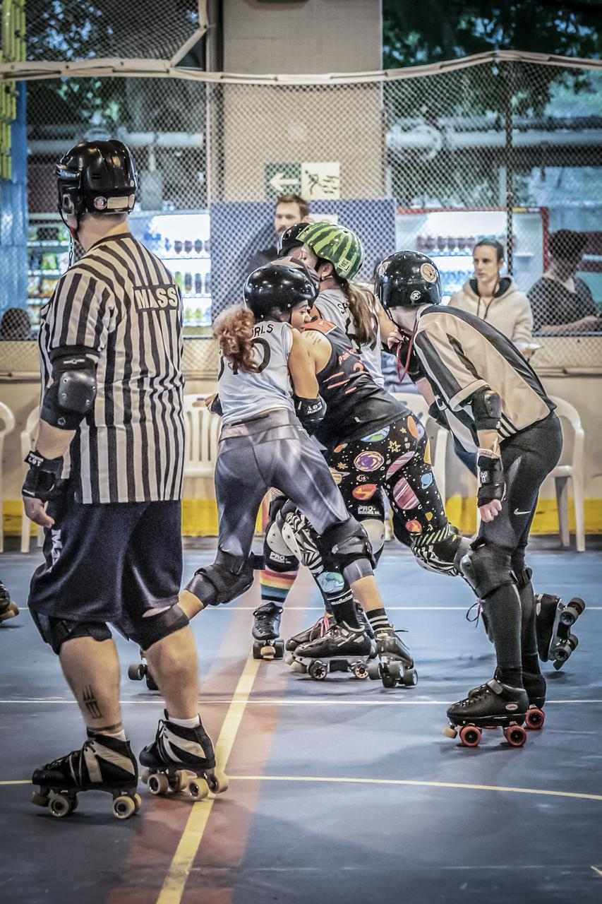 Two of UAE All-Stars' skaters (Mean Curls, Spinky) in blue as part of the Pan-Asian Spring Rollers team against hosts Hong Kong Roller Derby. Photograph by Teddy Tse