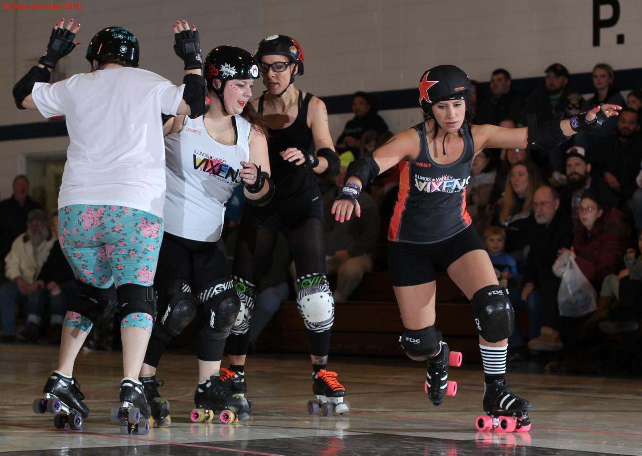 Illinois Valley Vixens Roller Derby during their first public bout under Short Track Rules.(Photo used by permission of Dave Schrader under license. [not covered by site CC license] )